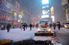 Workers shovel snow in Times Square in New York on February 8, 2013 during a storm affecting the northeast US. The storm was forecast to bring the heaviest snow to the densely-populated northeast corridor so far this winter, threatening power and transport links for tens of millions of people and the major cities of Boston and New York.