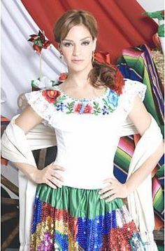 China Poblana Authentic Dress  This is Cynthia Vazquez in a beautiful China Poblana Dress also called Mexican Puebla Dress.  She used this dress in a soap opera by Mexico's most famous TV group: Televisa. The soap opera name was Bellezas Indomables which translates as Indomitable Beauties.  The dress is usually short sleeve embroidered but full length at the bottom with colorful sequin.  Because the dress is much more sophisticated than other more traditional Mexican dress choices, it is…