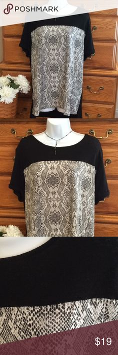 """Dress Barn Hi Lo Tunic NWT Knit, linen and rayon in the back and sleeves and 100% polyester in the front snake skin print. Approximately 30"""" in length in the back and a few inches shorter in the front.  When laid flat and measured from armpit to armpit it is 22 1/2"""" across.  Short sleeves button up.   Colors are black, gray and white.  Side slits. Dress Barn Tops Tunics"""