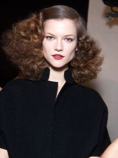 This look is an irresistibly modern, tousled take on 1940s Hollywood glamour.   After using a one-inch curling iron to create curls at ear level and below, deeply side-part your hair and secure it with the France Luxe Long & Skinny Barrette. Then, Mitch Stone suggests lightly spraying the Spornette Little Wonder ...