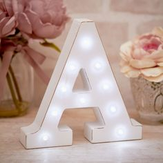 La De Da Living Vintage White LED Light Up Letters: Distressed white light up standing letters are the perfect accessory for weddings, parties, stylish homes and so much more. Choose your desired initial/s from a collection A-Z letters and an Ampersand – Who doesn't want their name up in lights?