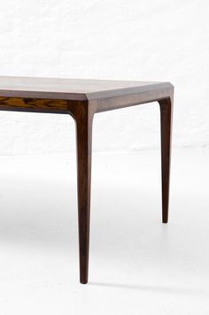 Clean lines, super minimal radius, and delicate legs.  Gorgeous.  -Johannes Andersen palisander coffee table at Studio Schalling