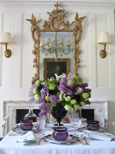 Green and lilac centerpiece by Carolyne Roehm.