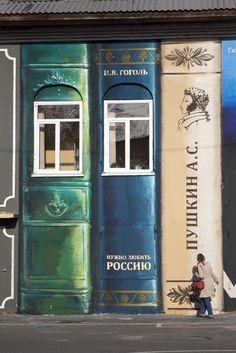 School facade in Tyumen, Russia, painted to look like a giant bookshelf
