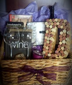 """This """"Wine Themed"""" wedding basket was designed for a couple getting married in beautiful Okanagan, BC. The custom cork monogram, custom made wine glasses, Newlywed book, bottle of wine, guest book and more, make this basket an ideal gift for any wine lover out there!"""