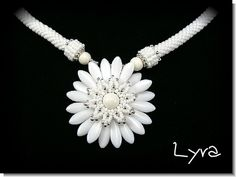 Wow - so much to like about this one! ...the beaded end caps, the petals, the monochromatic color scheme, the overall shape...love it!