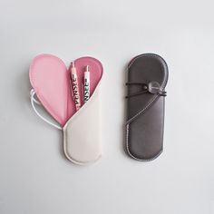 a leather pen case that opens to a heart