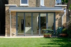 Balanced walls either side of door. Flat roof kitchen extension