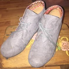 Gray wedge booties Great pair of Cato grey booties. Worn once. Too high for me and have been sitting in my closet. 2 inch heel. Very comfortable. Lace up front. No visa me damage that I see. Cato Shoes Ankle Boots & Booties