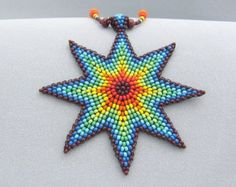 Seed Beed Rainbow Star NecklaceBeadwork by HANWImedicineArt Seed Bead Necklace, Seed Bead Jewelry, Star Necklace, Jewelry Art, Seed Beads, Beaded Necklace, Native Beadwork, Native American Beadwork, Beaded Flowers Patterns