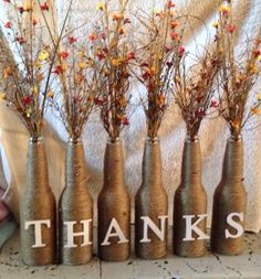 Beautiful Thanksgiving centerpiece by BowsofInterest on Etsy, $60.00..or save your own bottles ......and make your own.