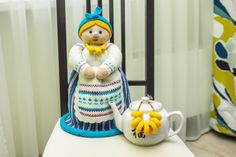 Doll maker. Doll-warmer for teapot. Present for tea fans. Due to doll «Dunyasha», tea in the teapot does not cool down and for a long time pleases guests by his rich taste and aroma. This original teapot warmer to lift spirits the guests and create in your kitchen the atmosphere of comfort and harmony. Kettle Warmer Doll will be a wonderful decoration for your dinning table and remarkably fit into the interior of your kitchen. Great gift for close friends who love the comfort of home and…