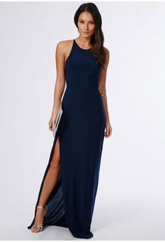 Slip into this slinky number this season for a seriously seductive look. With hot high neckline, chic split to the front and crossover to reverse this navy maxi dress is a dream. Style with stunning silver strappy heels and metallic clutch ...