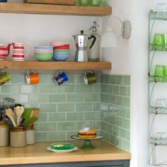 Green kitchen tiles We have cream kitchen doors, wooden counter and plan to have this colour and style of tile with open wooden shelves too. Kitchen Wall Tiles, Kitchen Doors, Kitchen Shelves, Kitchen Backsplash, New Kitchen, Kitchen Country, Metro Tiles Kitchen, Green Tile Backsplash, Cottage Kitchen Tiles