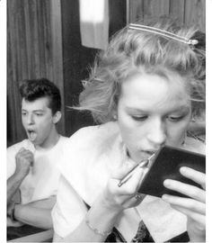 "Jon Cryer and Molly Ringwold on the set of""Pretty in Pink""."