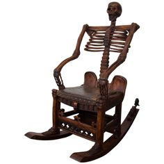 An Antique Hand-Carved Skeleton Rocking Chair | From a unique collection of antique and modern rocking chairs at http://www.1stdibs.com/furniture/seating/rocking-chairs/