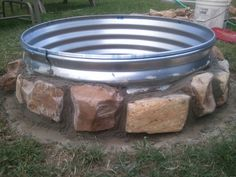 "36""X 12"" galvanized fire pit ring $38 at Rural King.River rock -free from local creek bedMortar -$14.58 for 3 bags (we bought 4 but only used 3)Clearing the grass from the spotLeveling the ringWe..."