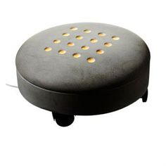 Tove Admans footstool in concrete is not only a lamp but also designed to have as a footstool. The concrete is heated up by 16 lights that allows one to warm his feetwhile it lits up from the floor and create a harmonious light.