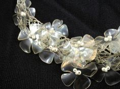 This is one of my treasures...Necklace made from recycled plastic bottles. Idea sent by Célia Machado !
