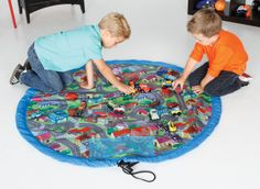 EZ-MAT Take and store your toy collection everywhere with the Toytainer EZ-Mat. A waterproof and washable drawstring playmat perfect for all types of play.  The Ez-mat features pockets for storage, velcro loop for hanging, shoulder carry strap and themed backgrounds to enhance play. When playtime is over, it's simple...collect toys inside and pull the EZ-mat together. Hang your Ez-Mat in the closet or take with you on the go.
