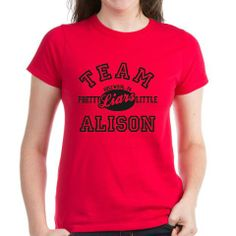 "These graphic tees and other items read ""Team Alison"" for fans of dead girl whose murder still haunts Rosewood from the TV show Pretty Little Liars."