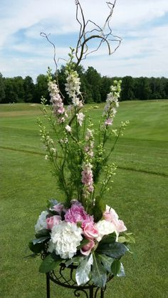 Larkspur,  curly willow, peonies,  roses and hydrangea altar arrangements.