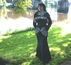 stunning velvet bolero with B striped cuffs and trim.  very Beetlejuice!!  fastens with a chinese braid closure at the neck