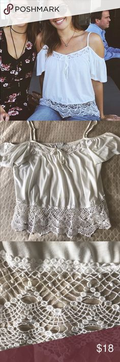 American Rag Crochet-Trim Cold-Shoulder Top This boho style open-shoulder top is a step up from the average cold shoulder top. The crochet-lace trim at the hem is a fun touch in addition to the tie at the neckline! The shirt is a size L but fits more like a medium. American Rag Tops Blouses