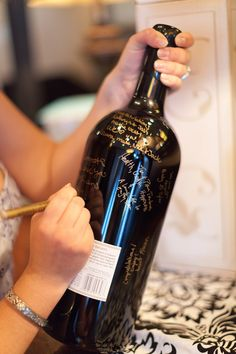 In lieu of a guest book, the couple had guests sign a magnum bottle of wine that they would share on their anniversary.