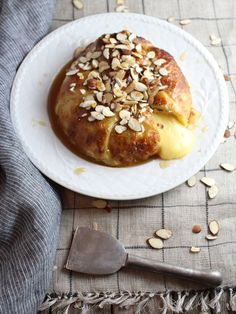 "If you're looking for a delicious & easy appetizer your search is over. Baked Brie swaddled in Puff Pastry with sliced Almonds and Honey is ""to live for!"""