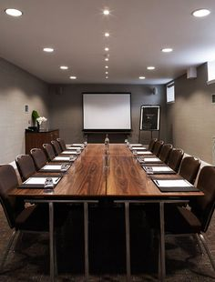 Meeting Room. Table with chairs along the sides, and projector/activboard.