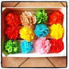 A splash of colour for a rainy day: pom pom flowers made with tissue paper!