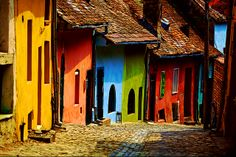 Street In Sighisoara, Transilvania, Romania Colourful Buildings, City Buildings, Strange Places, Cities In Europe, Medieval Town, Architecture Old, Europe Travel Tips, Adventure Is Out There, Skyscraper