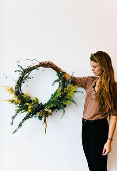 DIY Natural Christmas Wreath | 20 DIY Christmas Yard Decorations to Deck Out Your Outdoor Space via Brit + Co.