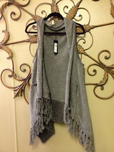 Grey Sweater than can go with ANY outifit!  Just throw it over and you're outfit is complete.  ONLY $42!