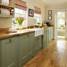 40 Adorable Cottage Style Kitchen Appliances Ideas - HomEnthusiastic : 40 Adorable Cottage Style Kitchen Appliances 49 Light Blue Backsplash Country Cottage Kitchen Accessories Six Gray Polished Iron Dining Chairs 7 Modern Farmhouse Kitchens, Farmhouse Kitchen Decor, Home Kitchens, Sage Green Kitchen, Farmhouse Ideas, Ranch Kitchen, Farmhouse Sinks, Country Cottage Kitchens, Country Cottages