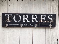 Personalized key holder with family last name and established date, on rustic wood