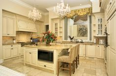 another french country kitchen..love the built in fridge