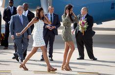 Hola España! Sasha and Malia Obama stride across the tarmac outside Madrid on Wednesday mo...