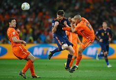 Nigel De Jong tackles Xabi Alonso  during the 2010 World Cup final between Netherlands and Spain at Soccer City Stadium on July 11, 2010 in Johannesburg, South Africa. (Laurence Griffiths/Getty Images)