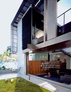 solar-umbrella-house-backyard-view-to-living-room