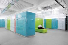Carvart lockers in back-painted glass and aluminum by Carvart.