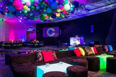 A view of the lounge area at this fun filled neon themed Bar Mitzvah. (Lighting/Dance Floor washes: @thelightersidela / Design & Production: @jowyproductions / Venue: @fslosangeles / Photography: @john_solano_photography / Balloons: @ballooncelebrations / Dance Floor & Risers: @barkerdecor / Floral: @cjmatsumoto / Entertainment: @checkone2ent)