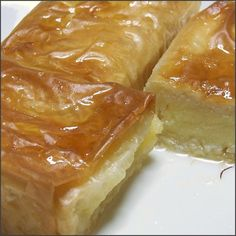 Galaktoboureko - Custard Pies This classic Greek dessert can be found throughout Greece and is widely available in bakeries, pastry shops and snack bars. Greek Sweets, Greek Desserts, Greek Recipes, Pie Recipes, Just Desserts, Dessert Recipes, Copycat Recipes, Yummy Recipes, Breakfast Recipes