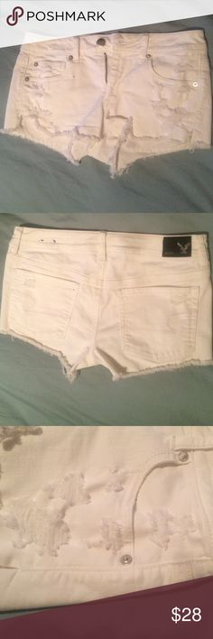 Ameican Eagle super stretch jean shorts size 8. american eagle. white. suer stretch short. destroyed jean shorts. has holes on both sides, the pockets stick out of the bottom a little. only worn about 5 times.  selling because too short for me. NO TRADE PRICE IS FIRM American Eagle Outfitters Shorts Jean Shorts