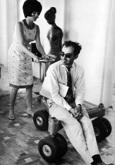 "Brigitte Bardot & Director Jean-Luc Godard on the set of ""Le mépris"" (1963)."