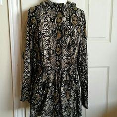 Danielrainn top In excellent condition long sleeve top. Hood.  Front zipper. Front  Pockets . Waist and bottom  Strings. 100% polyester. Daniel Rainn Tops Blouses