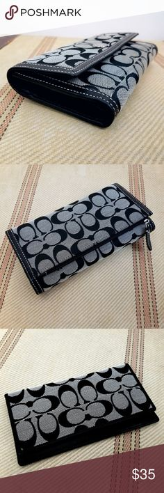 COACH Black & White Wallet and Checkbook Cover Like new condition, never used Zipper pocket on outside Black leather interior Real color is a tan gray not the bluish gray in the pics. Price is firm Coach Bags Wallets
