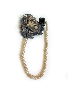 Viktoria Münzker Brooch: Under pressure 2008 Silver, black garnet, old beads 4 x 10 x 1,5 cm