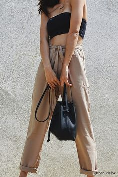 Style Deals - A pair of woven trousers featuring an attached self-tie belt, slanted front pockets, an elasticized waist, a zip fly, and a wide straight-leg design.